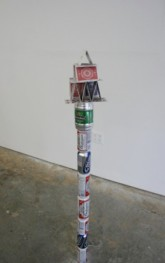 Tony Matelli. Yesterday. 21½ x 6 x 4½ in. Painted bronze, rub-on transfers, beer cans. 2009.