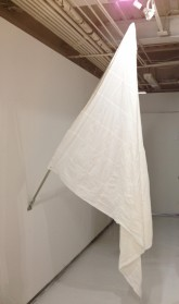 Elodie Lombarde. White Flag. Tissues, thread, and flag pole. 72.24 x 57.6 inches. 2012.