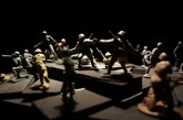 Aurélie Arqué. Child's Play. Plastic soldiers, flash light, model train set, wood. Dimensions variable. 2012